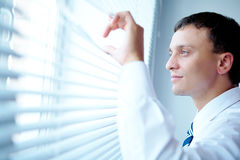 Looking out of the window Royalty Free Stock Images