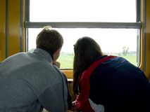 Looking out window. 2 people looking out window on train Stock Photo