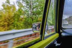 Looking out of the window of this vintage car as it travels alon. G the motorway.  Shows motion in side view Stock Photo