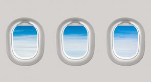 Looking out the windows of a plane to the blue sky and clouds Royalty Free Stock Photos