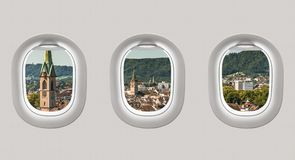 Looking out the windows of a plane to the city of Zurich Royalty Free Stock Image
