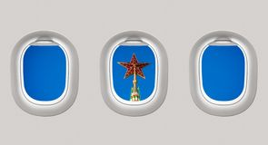 Looking out the windows of a plane to the red star, Russia Stock Photos