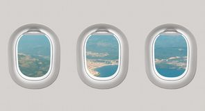 Looking out the windows of a plane to the sea bay Royalty Free Stock Images