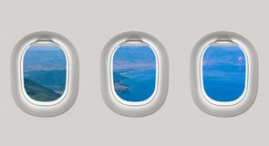 Looking out the windows of a plane to the sea bay Stock Photos