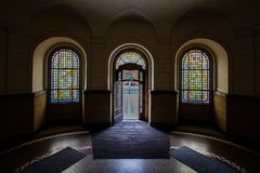 Looking Outside Via Arched Door And Colorful Arched Window Royalty Free Stock Photos