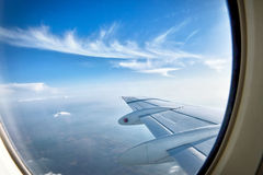 Looking over aircraft wing in flight Stock Image