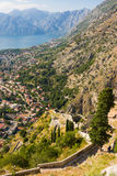 Looking over the Bay of Kotor in Montenegro with view of mountains, boats and old houses with red tile roofs Stock Photography