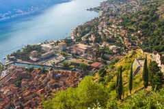 Looking over the Bay of Kotor in Montenegro with view of mountains, boats and old houses with red tile roofs Royalty Free Stock Photo