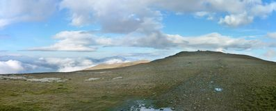 Looking over clouds from Helvellyn, panoramic Royalty Free Stock Photos