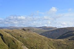 Looking over eastern fells, Lake District. The near blips are Little Hart Crag as seen over Scandale Head from near Dove Crag royalty free stock photography
