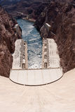 Looking over the edge of the Hoover Dam. Hoover Dam, once known as Boulder Dam, is a concrete arch-gravity dam in the Black Canyon of the Colorado River, on the Stock Images