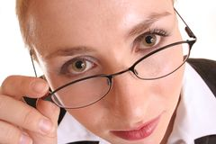 Looking over glasses. Woman with spectacles Stock Image