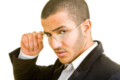Looking over glasses. Business man looking over his glasses Stock Photography