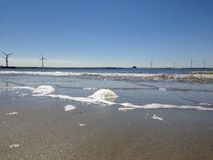 North sea beach, the sea and the delta works and mills royalty free stock photos