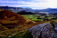 Looking over Keswick from Causey Pike. Snow covered mountains around Keswick Royalty Free Stock Photo
