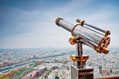 Looking Over Paris. A telescope on the Eiffel Tower and an aerial view of Paris Stock Photography