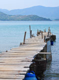 Looking over a pier. On sea royalty free stock photo