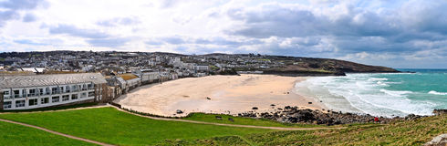 Porthmeor beach in St Ives Cornwall UK. Looking over Porthmeor beach in St Ives Cornwall with the Tate art gallery situated prominently Royalty Free Stock Images