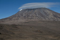 Looking over The Saddle to Kilimanjaro. Looking over The Saddle on Kilimanjaro towards Kibo huts and the route up to Gilmans Point 5686m on the rim of crater Royalty Free Stock Image