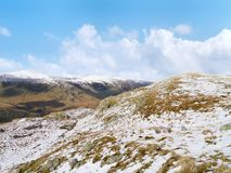 Looking over snow-capped mountain Royalty Free Stock Photography