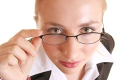 Looking over spectacles. Lady looking over glasses Stock Images