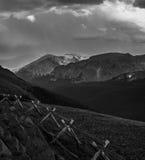 Looking over split rail fence towards alpine peak Royalty Free Stock Image