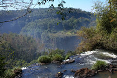 Looking over the top of a waterfall. View from the top of a waterfall in Argentina Royalty Free Stock Photography