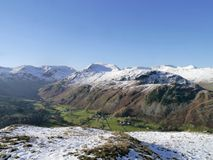 Looking over valley to snow-capped mountains, Lake District Stock Images