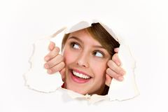 Looking through paper hole Royalty Free Stock Images