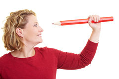 Looking at pencil Stock Photos