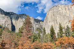 Autumn views from Yosemite Valley. Looking at pine forest and famous cliffs at Yosemite National Park, Mariposa County, California, USA stock photography