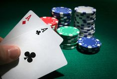 Looking at pocket aces during a poker game. Close up Stock Photo