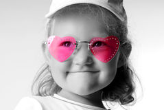 Looking positiv. Child with pink glasses Royalty Free Stock Photos