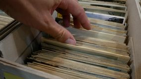 Looking for postcards in the binder. Numismatic marketplace for collectors stock video footage