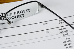 Looking at profit. Focus on the profit statement of a financial report Stock Images