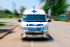 Ambulance speeding to accident, Emergency ambulance travels through city street zoom effect. Looking from the rearview mirror Ambulance speeding to accident stock images