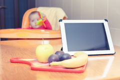 Looking for recipe of preparation baby food at tablet pc Stock Photo