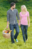 Looking for the right place for picnic. Loving young couple is g Stock Photography