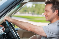 Looking at the road and smiling Stock Photos