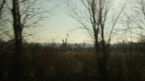 Rural village view from moving car. Looking at the roadside from a car in slow motion stock footage