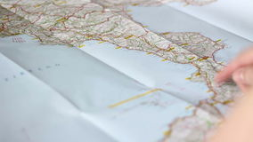 Looking at a route on a map stock footage