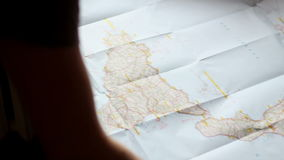 Looking at a route on a map. Top view. Man Looking at a route on a map. Top view stock video