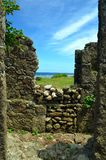 Looking through the ruins. Batanes Ghost town, stone-houses destroyed by a tsunami in the 1950's Royalty Free Stock Photo