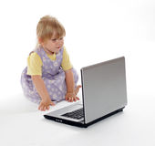 Looking on screen of laptop little girl Royalty Free Stock Photography