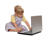 Looking on screen of laptop little girl Stock Images