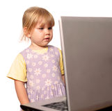 Looking on screen of laptop little girl Royalty Free Stock Image