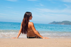 Looking at the sea girl in bathing suit Royalty Free Stock Photography