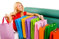 Looking through shoppingbags Royalty Free Stock Photos