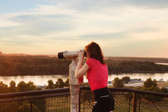 Looking through sightseeing  binoculars Royalty Free Stock Photography