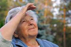 Looking into the sky. An elderly woman looking into the sky Royalty Free Stock Image